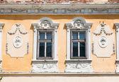 Two windows on orange wall , Sibiu, Romania — Stock Photo