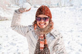 Happy young woman playing snowball fight — Stock Photo