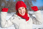 Happy young woman on the snow sunny day — Stock Photo