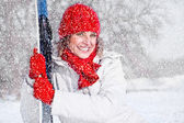 Beautiful woman with snowboard on the snow day — Stock Photo