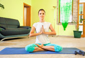 Young beautiful woman preparing for meditation — Stock Photo