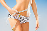 Woman measuring perfect shape of beautiful hips. — Stock Photo