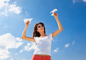 Young caucasian girl with two paper planes — Stock Photo