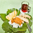 Nasik famous dish from Java served  on leaf - Stock Photo