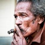 Cubans smoking cigar — Stock Photo