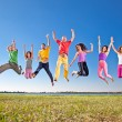 Happy smiling  group of jumping — Stock Photo