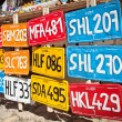 Stock Photo: Traditional handcrafted Vehicle registration plates for sale in