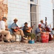 Stock Photo: Traditional musicians playing in streets in Trinidad, Cuba.