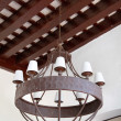 Iron luster colonial style on a ceiling - Stock Photo