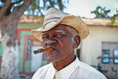 Cuban man smoking a cigar. Trinidad, Cuba. — Stock Photo