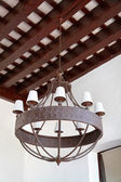 Iron luster colonial style on a ceiling — Foto Stock