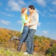 Happy young couple spending time outdoor in the park - Stock Photo