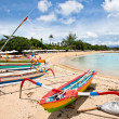 Traditional fishing boats on a beach in Sanur on Bali — Stock Photo #21294179