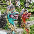 Traditional balinese dragon monster secure the gate of temple, B - Stock Photo
