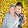Happy couple have a romance in fall  — Stockfoto