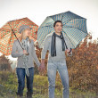 Young couple under an umbrella on the rain - Lizenzfreies Foto