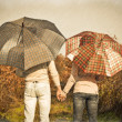 Royalty-Free Stock Photo: Young couple under an umbrella in the forest