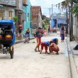 Typical afternoon scene on Cuban street. - Stock Photo