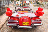 Red Classic Chevrolet in the central square of Trinidad, Cuba. — Stock Photo