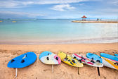 Surf boards on idyllic tropical sand Nusa Dua beach, Bali — Stock Photo