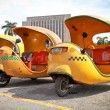 Stock Photo: Yellow coco taxi in Havana