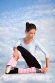 Beautiful ballerina sitting at cloud — Stock Photo