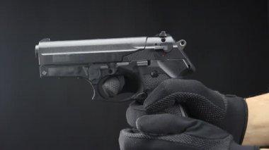 Hand holds firearm — Stock Video
