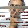 Accountant with abacus — Stock Photo #13679813