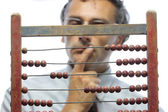 Accountant with abacus — Stock Photo