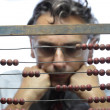 Accountant with abacus — Stock Photo #13719993
