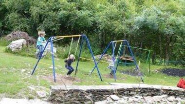 Children on a swing — Stock Video #13768847