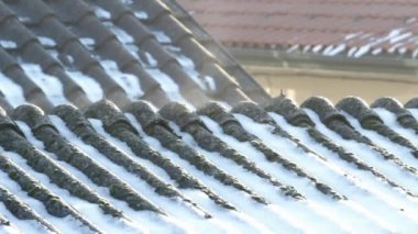 Evaporation on asbestos roof covering in the morning on a cold winter day — Stock Video