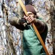 Mwith longbow in woods — Stock Video #18942589
