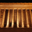 Stock Exchange building at night in Rome - Stock Photo