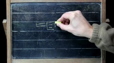 Teacher draws on the board — Stockvideo