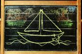 Sailing boat on chalkboard — Stock Photo