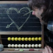 Man wipe the chalk board with heart on it - Stock Photo