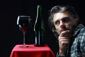 Portarit of man with wine — Stock Photo