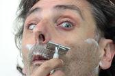 Shaving with vintage razor — Stock Photo