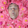Stock Photo: Flower mmakes face