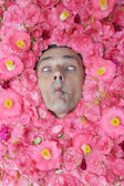 Flower man makes a face — Stock Photo