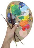 Hand holding palet en borstel — Stockfoto