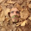 Man's face among the autumn leaves — Stock Video #28018317
