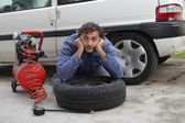 Man and tire puncture — Stock Photo