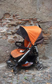 Abandoned stroller — Stock Photo