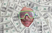 Man diving in dollar notes — Foto Stock