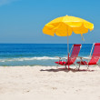 Beach chairs and umbrella on beach in Rio de Janeiro - Stock Photo
