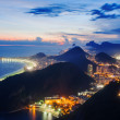 Stock Photo: Night view of Botafogo and Corcovado in Rio de Janeiro.