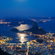 Night view of mountain Sugar Loaf and Botafogo in Rio de Janeiro — Stock Photo #25941319