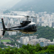 Stock Photo: Excursion helicopter taking off and Botafogo in Rio de Janeiro